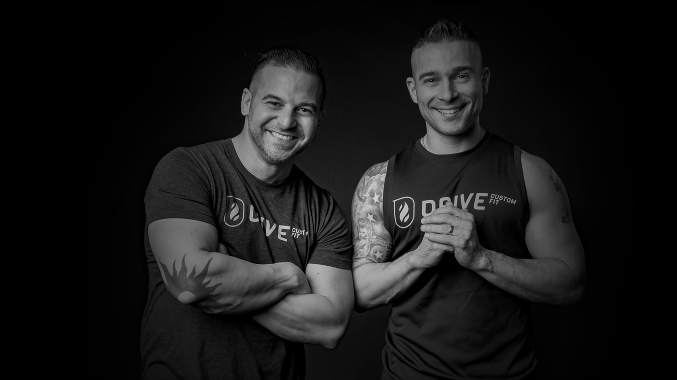 Two men smiling in Drive Custom Fit shirts